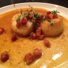 Scallops and pancetta with a spice rub white wine sauce.