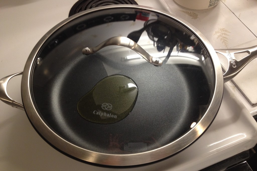 Calphalon skillet with glass lid.