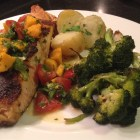 Salmon with mango tomato salsa served with parsley buttered boiled potatoes and roasted broccoli.