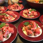 Watermelon salad with feta and mint on multiple plates