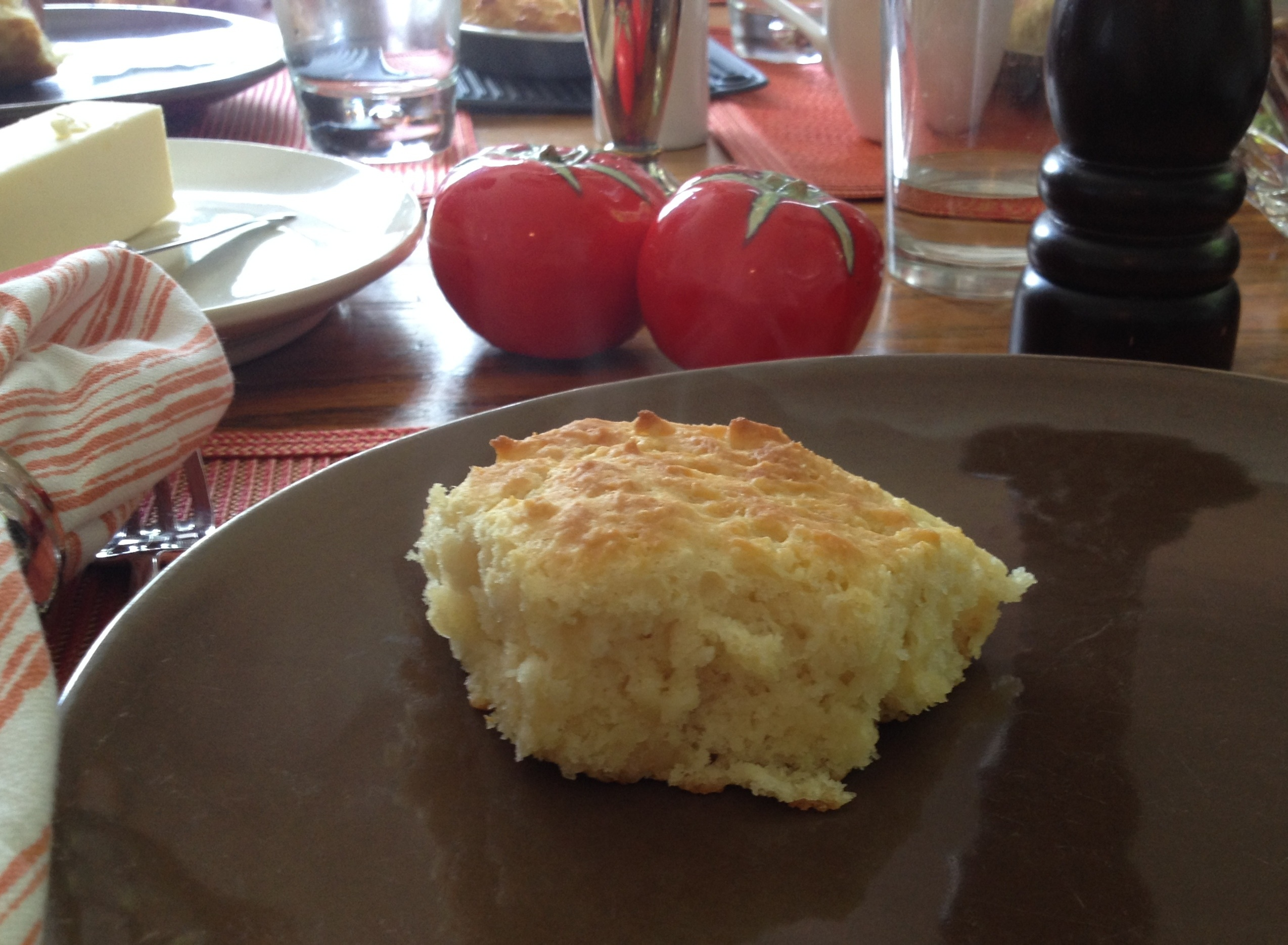 Homemade biscuit on a brown colored plate.
