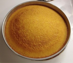 Olive oil cake cooling in a pan.