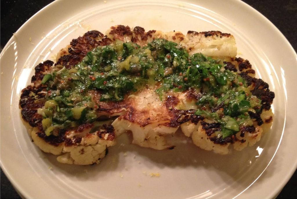 Grilled cauliflower steaks with an herb salsa verde.