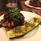 Chili Chocolate Pork Chops with Apple Aplenty on two plates on table