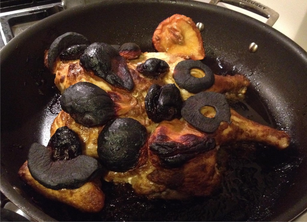 Mustard and cumin chicken with charred dried fruit on top.