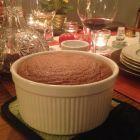 Chocolate souffle on a candlelit dining table