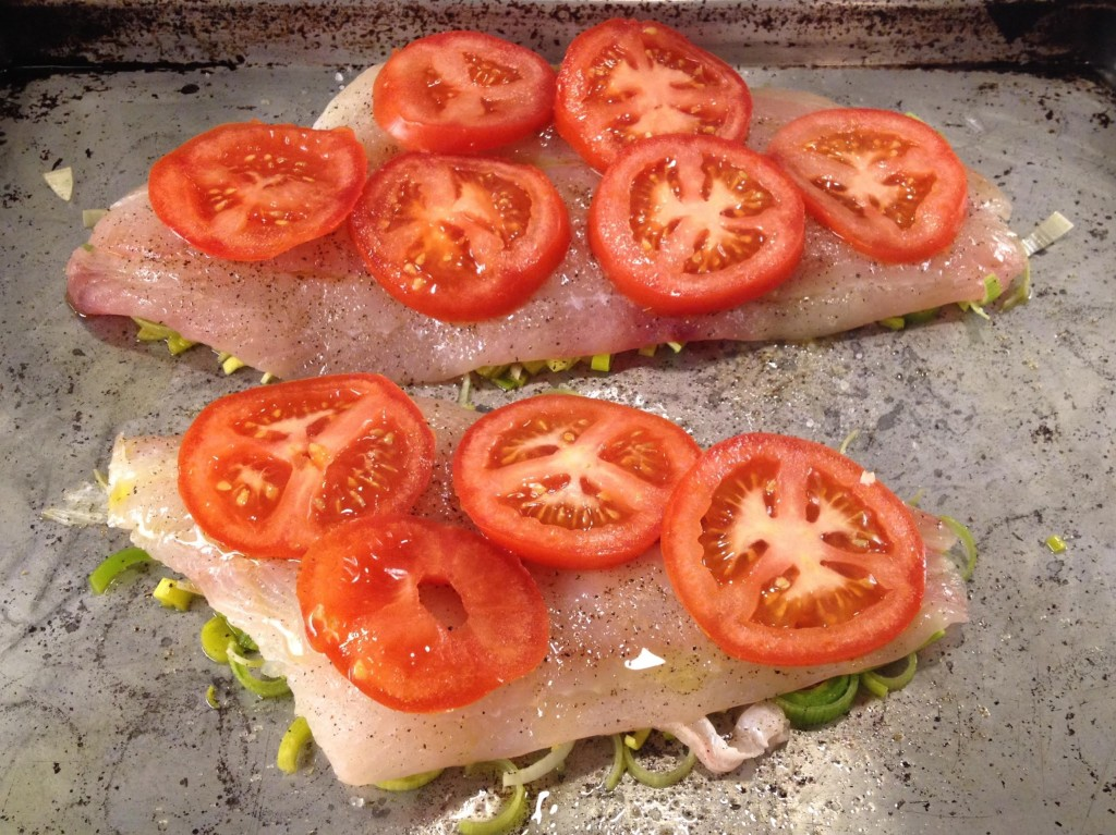 Preparing Lemon Sole raosted with leeks and tomatoes ready to go into the oven.