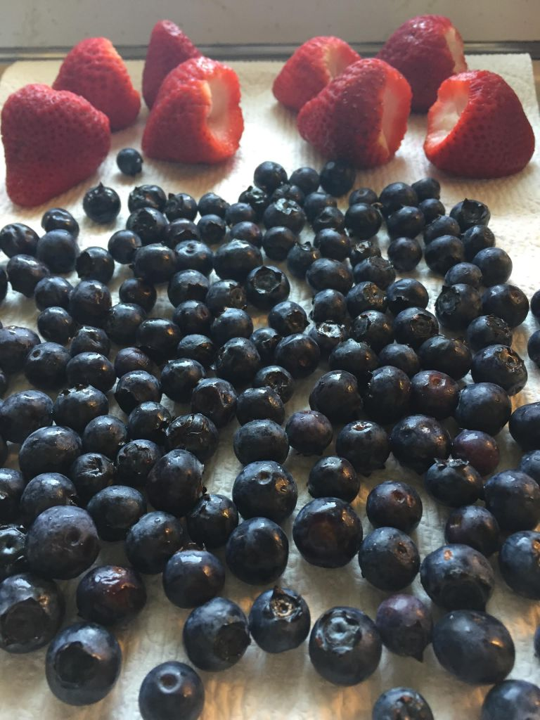 Strawberries and blueberries air drying.