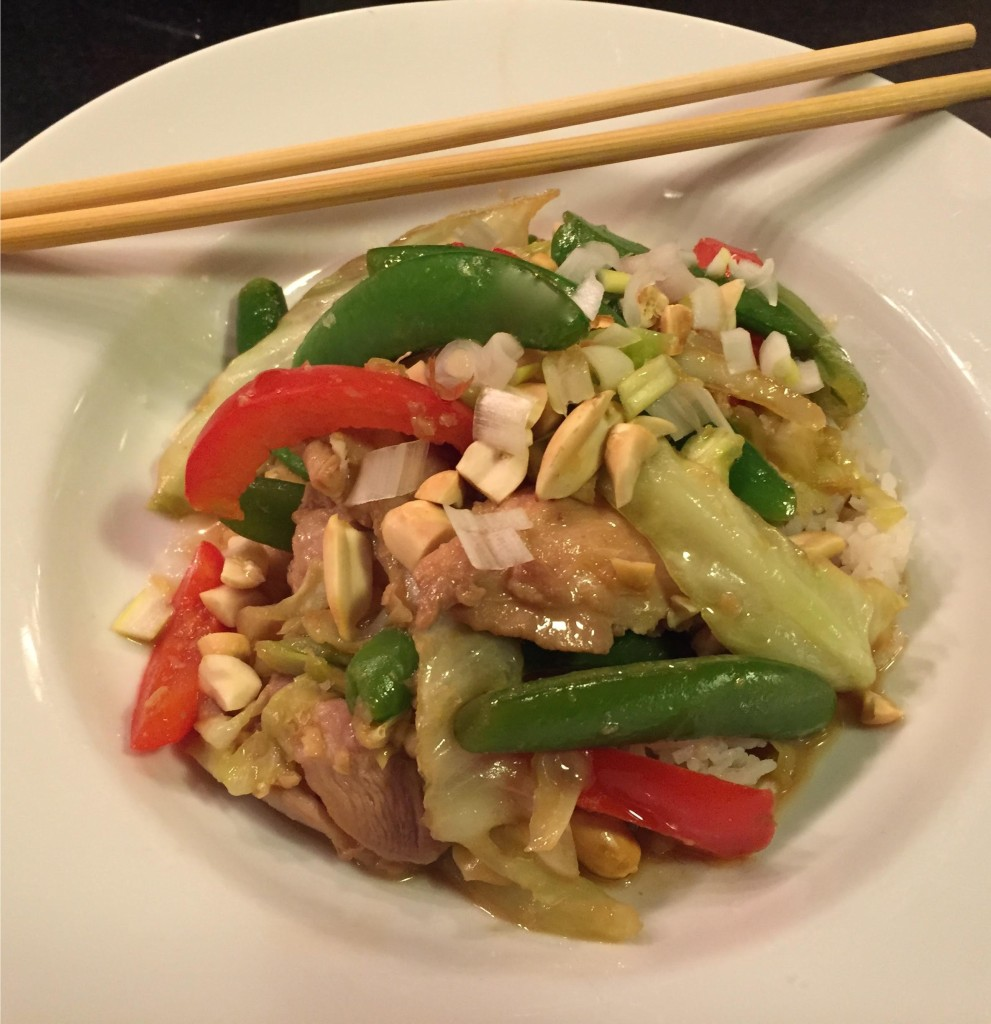 Super quick chicken and summer vegetables stir-fry in a white bowl with chopsticks.