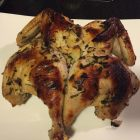 Buttermilk marinated roast chicken with tarragon & Dijon mustard on a platter.