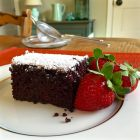 Ultragrain multigrain flour in Made in the Pan choc. cake piece cut with strawberries.