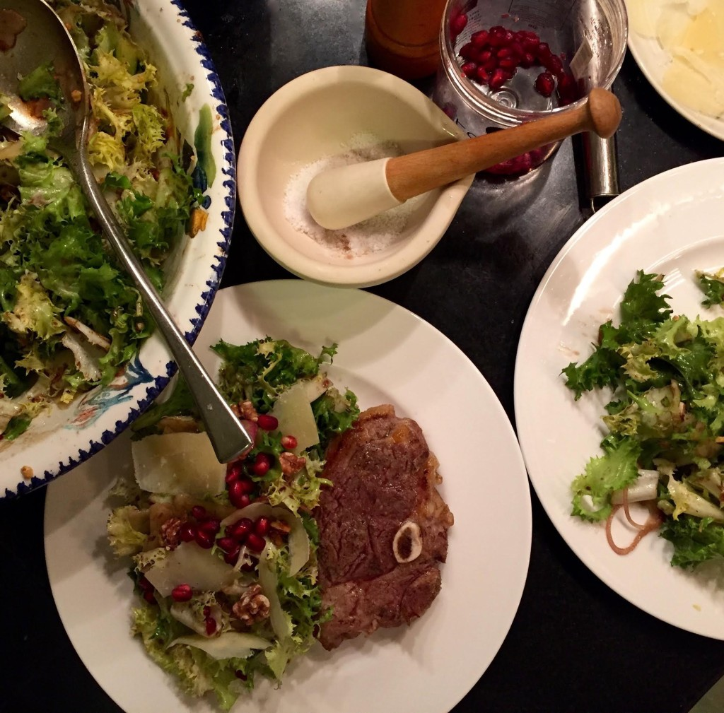 Chicory salad with pomegranate seeds -serving it up.