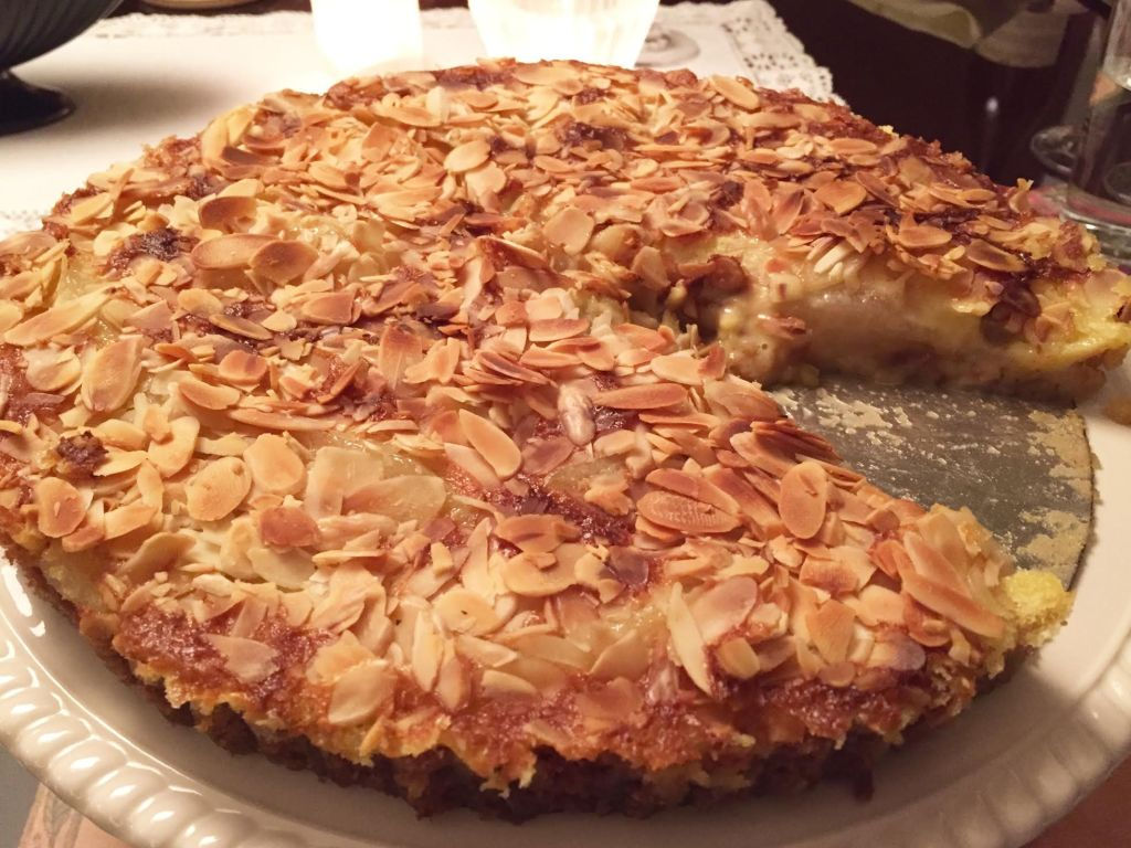 Honeyed Pear Clafouti Tart topped with sliced almonds.