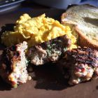 Delicious Sunday Morning Breakfast Sausage Patties on plate with eggs.