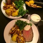 RawSpiceBar Winter Herb Rub on beef rump roast on platter and plated.