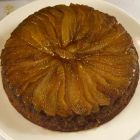 Pear and brown sugar upside down cake on a white platter.