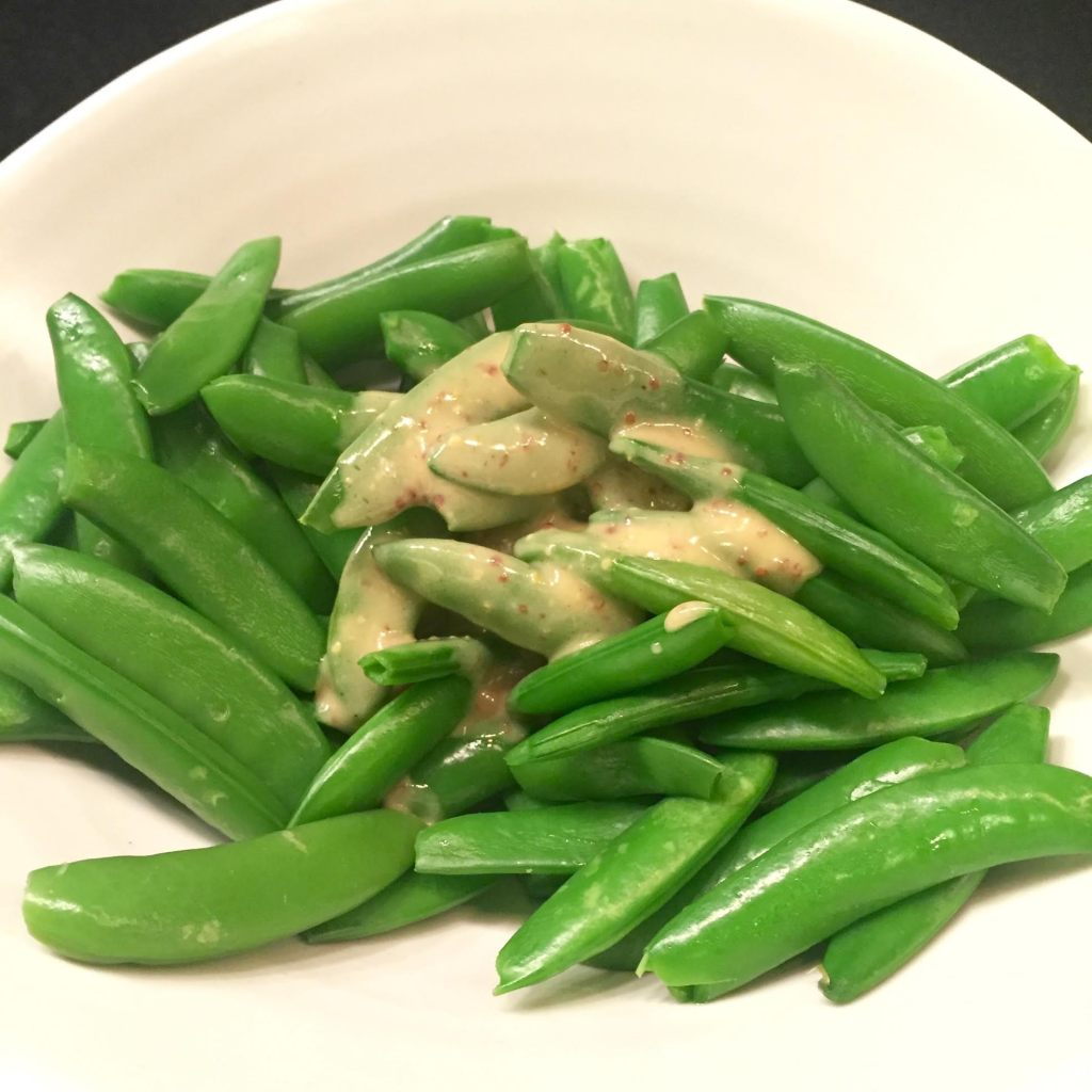 Sir Kensington's Dijonnaise on sugar snap peas in a Simon Pearce bowl.