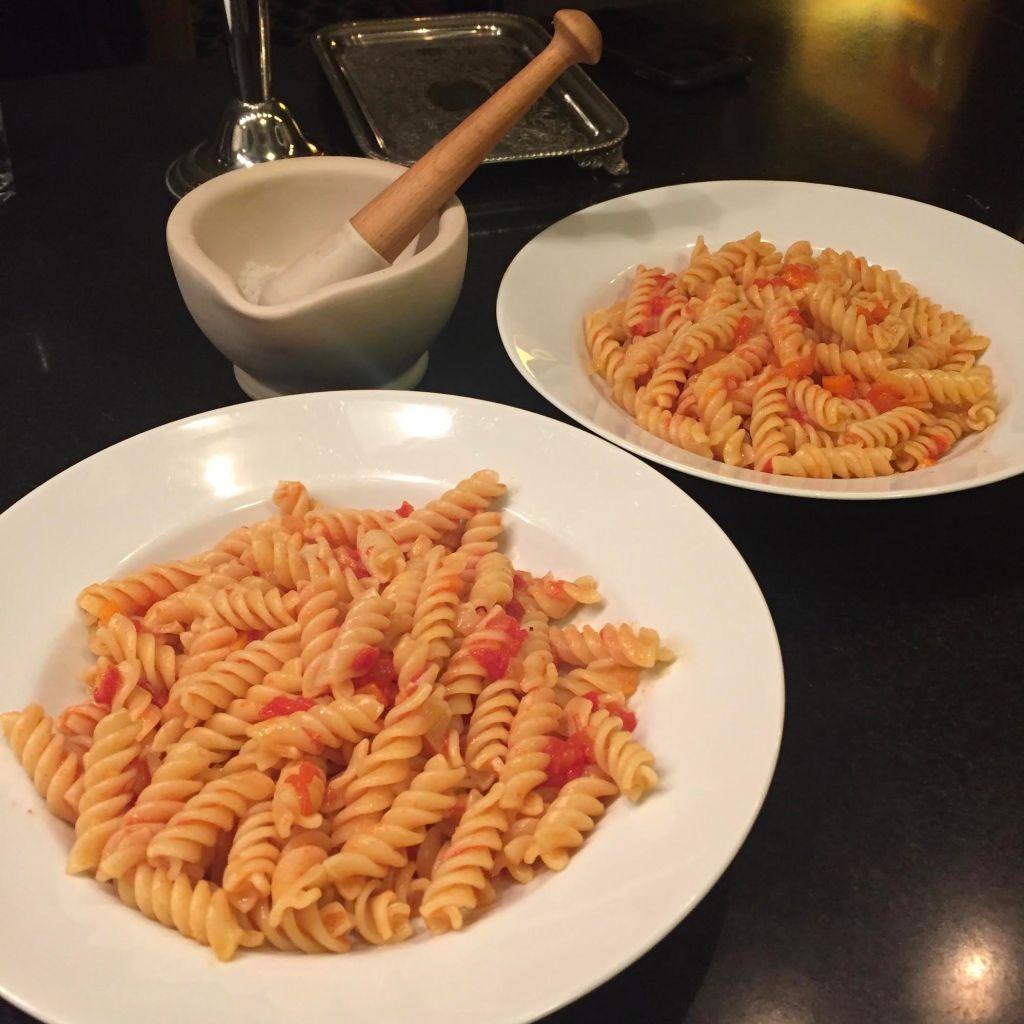 Nonna's Pomarola Sauce on fusilli in white bowls.