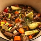 Easy lamb stew ready to roast in a Le Creuset pot.