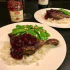 Felix Lingonberry jam on Chinese 5 Spice duck legs on a bed of rice on a white plate.
