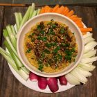 Roasted butternut squash dip with Home Cook's Pantry Za'atar on a platter with crudites.