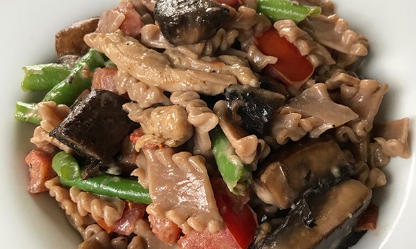 Farro Pasta with Portobello Mushrooms, Chicken, Tomatoes, and Green Beans in a Sherry Cream Sauce.