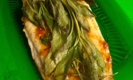 Grilled Flounder with Sweet Tomato and Chili Chutney, Rosemary and Sage hot off the grill on a green glass platter.