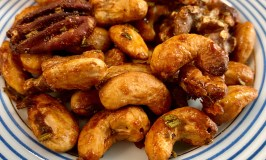Spicy Maple Glazed Nuts are not too sweet, not too spicy, on a blue rimmed plate..