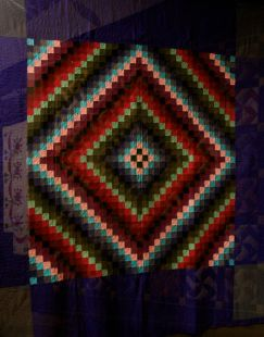 A poor photo of a fab Amish quilt