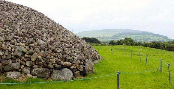 Carrowmore passage tomb with another visible on top of the distant hill