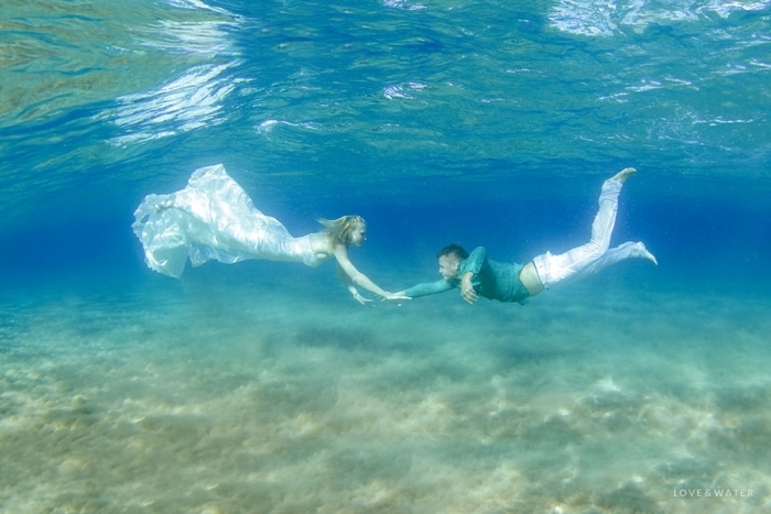 Underwater trash the dress photography Maui