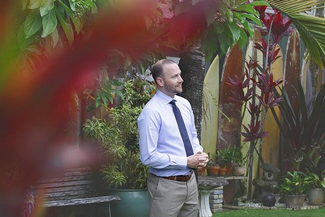 Kauai elopement groom prep by www.lovewaterphoto.com first look