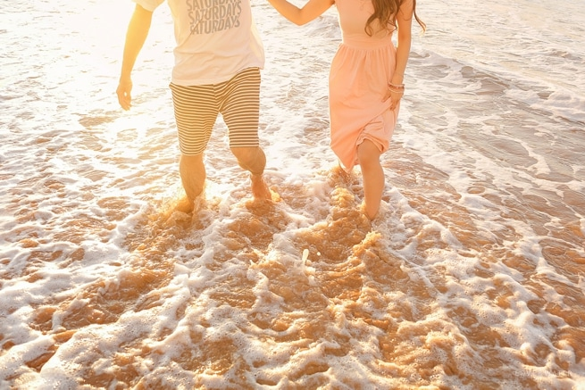 Maui couple holing hands beach engagement session