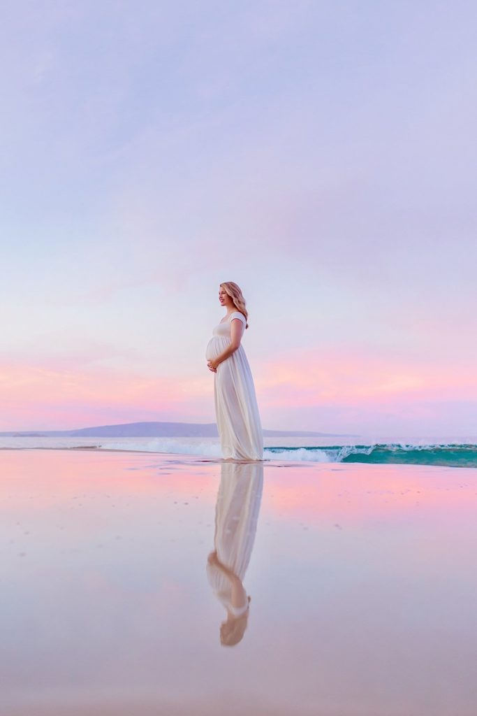 Maui maternity portraits beautiful blond woman holding pregnant belly