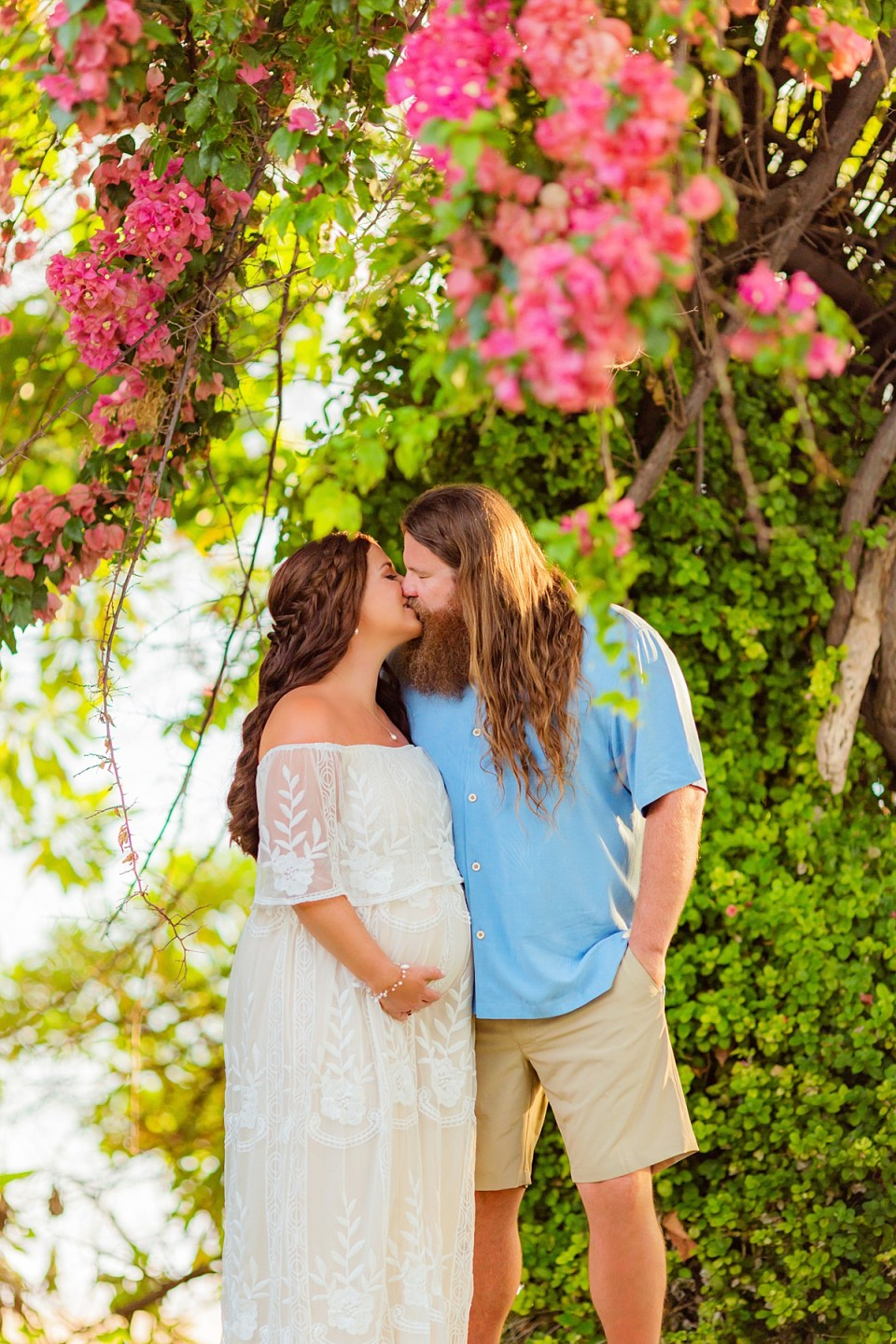 Beautiful Maui beach maternity session with bougainvillea in foreground