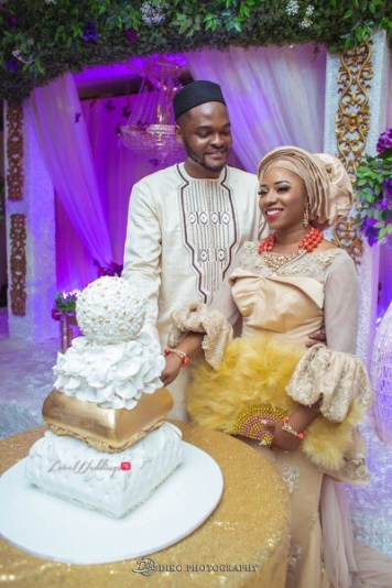 Nigerian Traditional Wedding Couple cutting the cake Uche and Emeka Diko Photography LoveWeddingsNG.jpeg