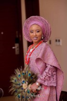 Nigerian Yoruba Traditional Wedding Ibitola & Ademola Bride with peacock hand fan Ijalana Oke LoveWeddingsNG 1