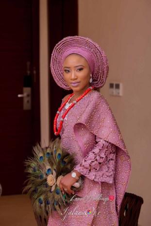 Nigerian Yoruba Traditional Wedding Ibitola & Ademola Bride with peacock hand fan Ijalana Oke LoveWeddingsNG