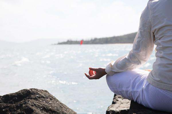 woman-doing-yoga-on-rocks