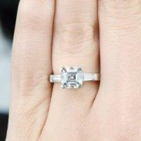asscher cut diamond ring on finger