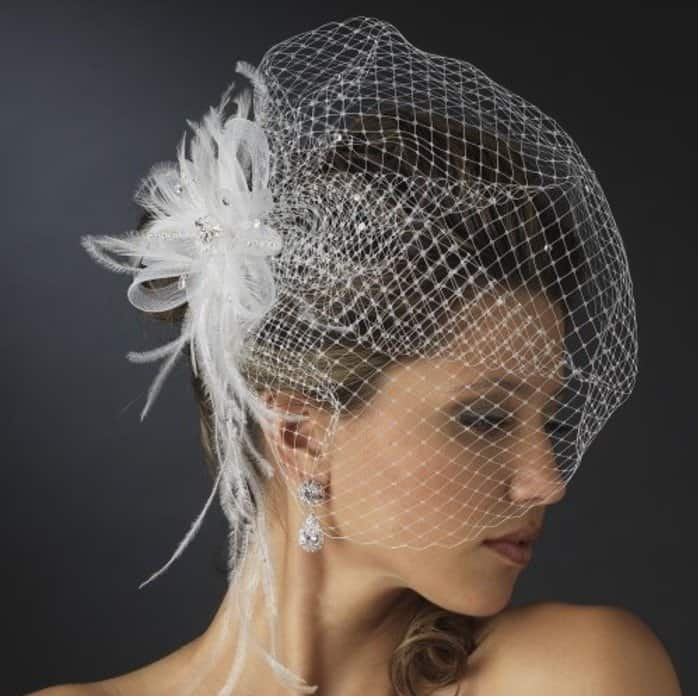 This is another fascinator with veil that has netting long enough to cover  the face from any location in the hair. It s stunning when pinned to the  back of ... 707b5316b0e