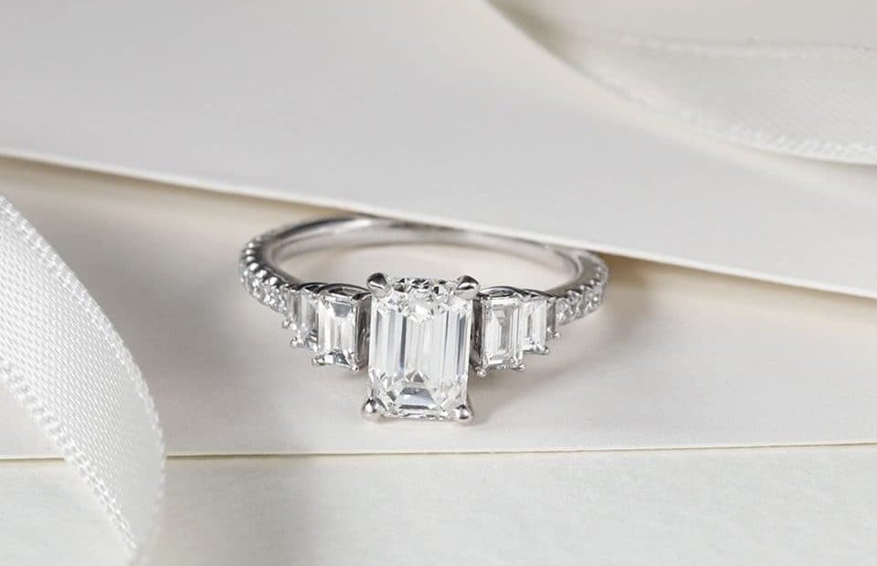 a beautiful diamond ring with an emerald cut