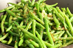 Sauteing green beans in a pot with garlic