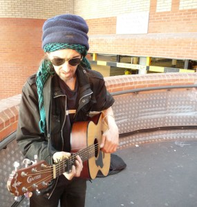 Busker Michael at the car-park entrance of Kingsland Centre Lon E8