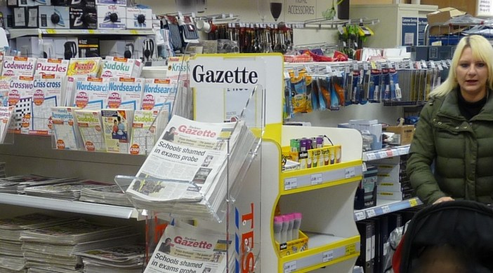 Newsstand showing newspapers laid flat (apart from local paper) @ Tesco store Morning Ln Hackney E8 291114 © david.altheer@gmail.com