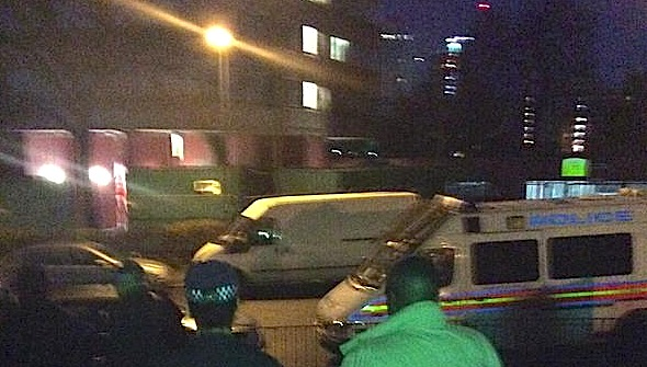 Police escort a man from the hostel in Stamford Hill N16. Picture courtesy of Hackney MPS