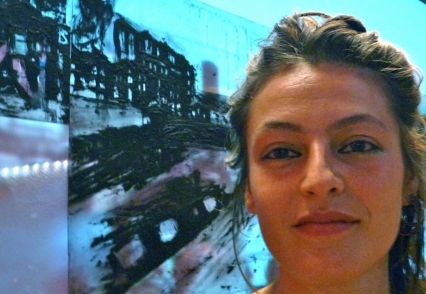 Interface15: Jasmina in front of her print collage at Interface ex. at Barbican London 210815 © david.altheer@gmail.com