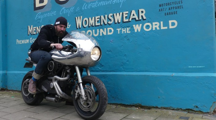 AndrewAlmond©DA0418: Bolt bike restoration and fashion store owner Andrew Almond at his Stoke Newington N16 0AH store on a restored motorcycle 130418© david.altheer@gmail.com