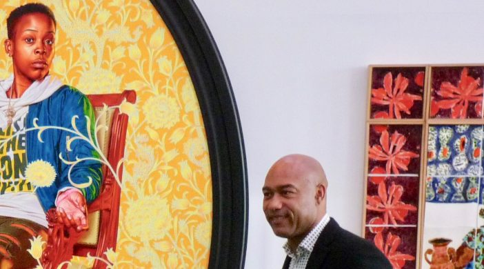 VandA©DA21gus: V&A East director Gus Casely-Hayford at VandA East PR event in Here East (ex Olympic 2012 media centre) in front of Kehinde Wiley's 2020 portrait of Melissa Thompso met in Ridley Rd Market, Dalston, 300621