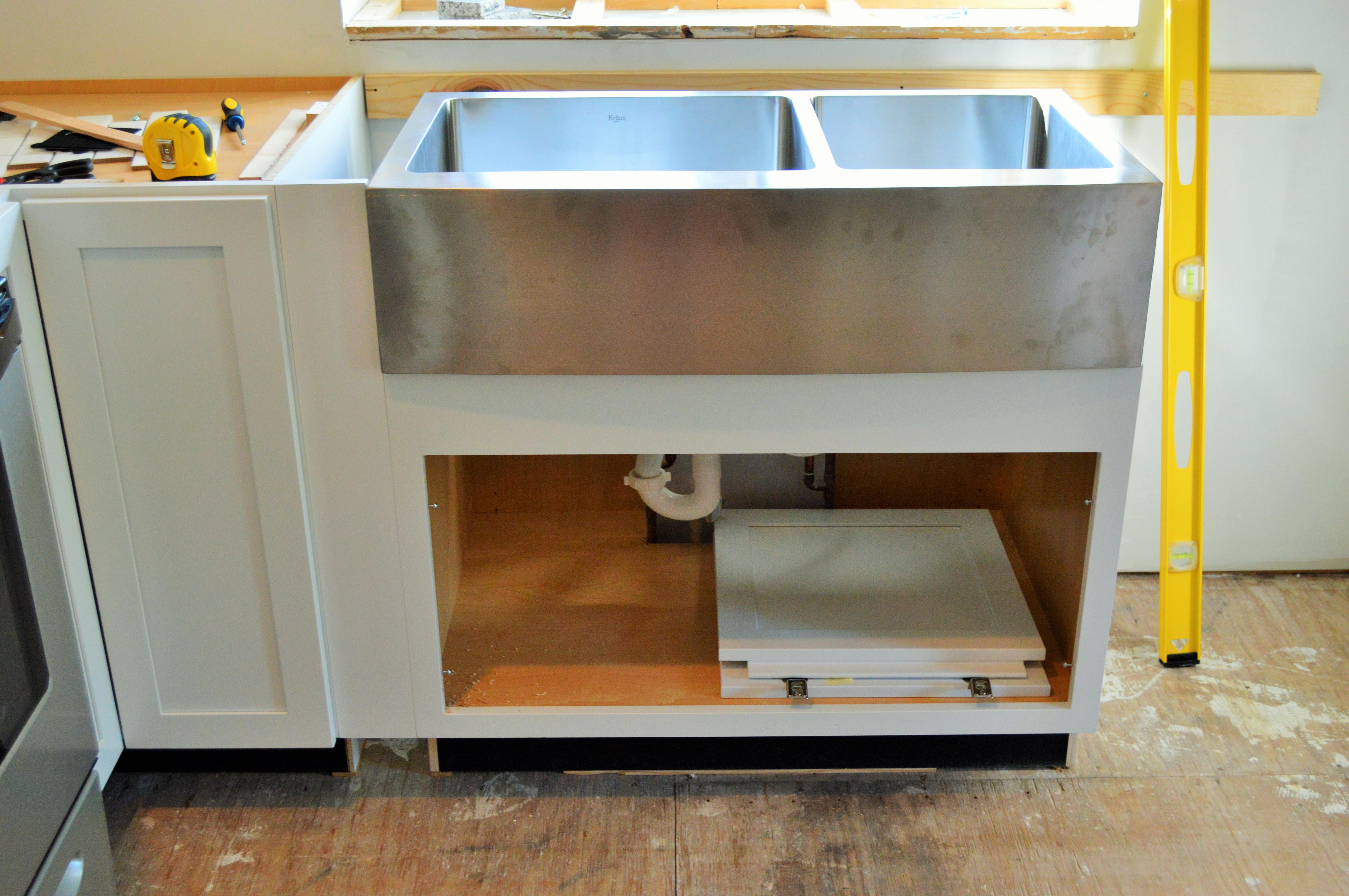 diwyatt adjusting the apron sink base before installation loving here